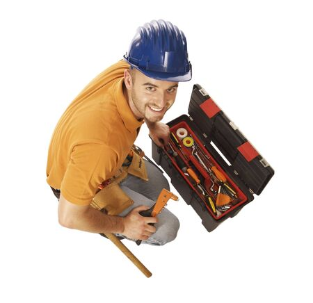 journeyman technician: young caucasian mantool isolated on white with toolbox, view from above