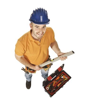 young constructor worker with spirit level and toolbox isolated on white Stock Photo - 5465659