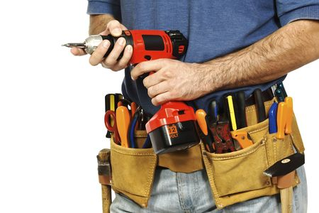 detail on handyman manual worker, toolsbelt and red drill in his hands photo