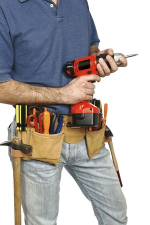 journeyman technician: detail on handyman manual worker, toolsbelt and red drill in his hands