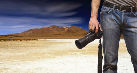 detail of photographer and desert mountain background
