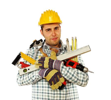 journeyman technician: portrait of young caucasian handyman with lots of different tools