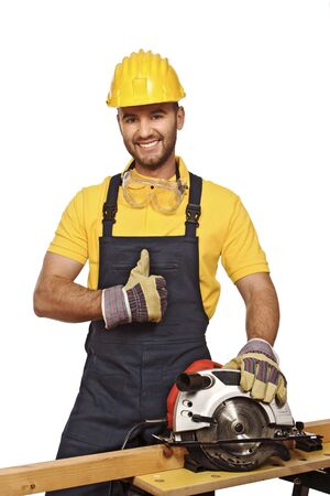 journeyman technician: positive manual worker smile and show thumb up isolated on white Stock Photo