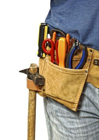cinturon seguridad: herramienta de manitas, detalle sobre el cintur�n de cuero aislado sobre fondo blanco