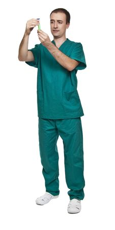 portrait of young doctor wearing vlassic green hospital clothes photo