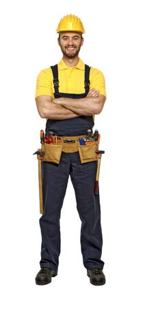 journeyman technician: classic pose of young caucasian confident smiling handyman isolated on white background