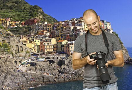 young photographer look the camera, cinque terre background photo