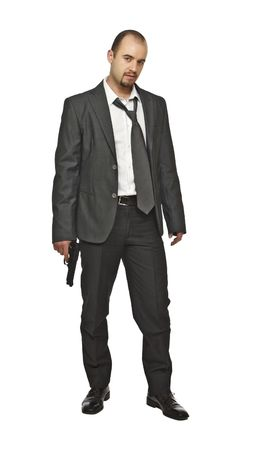 man standing and holding a pistol isolated on white photo