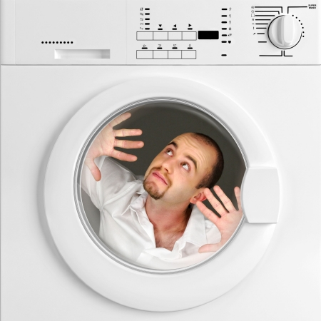 man machine: funny portrait of man inside washing machine, household life