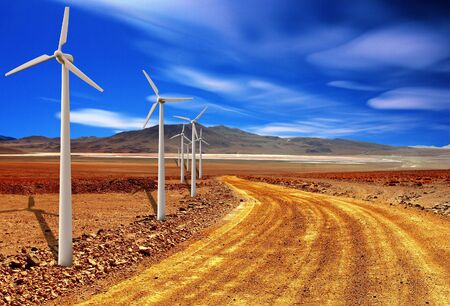 windturbine: wind turbine in the desert with blue sky background