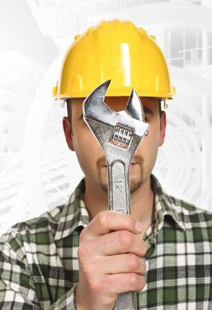 portrait of young handyman with wrench infront of him Stock Photo - 6527080
