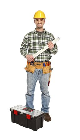 handyman with spirit level and tools isolated on white background Stock Photo - 6542976