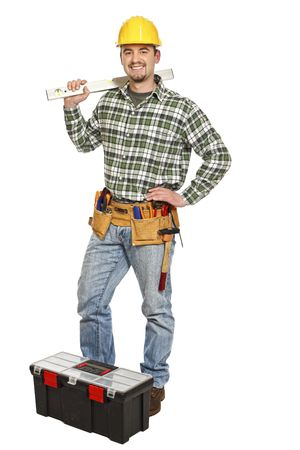 young standing manual worker and tools isolated on white Stock Photo - 6542975