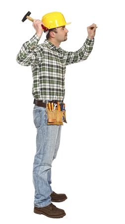 young manual worker with hammer and nail isolated on white Stock Photo - 6542978