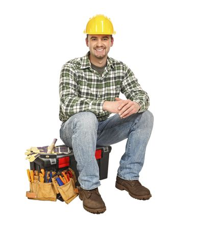 young handyman sit on his toolbox isolated on white Stock Photo - 6542906