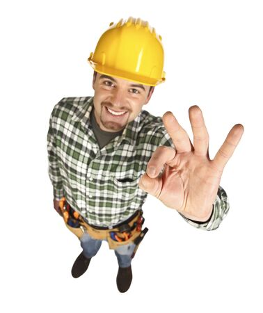 good guys:   young smiling handyman show positive attitude, isolated on white