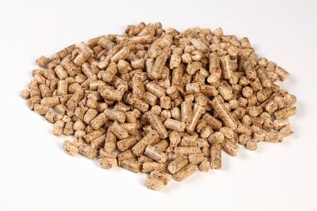 wood heating: fine closeup image of natural wood pellet on white Stock Photo