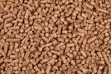 wood pellet: fine closeup image of natural wood pellet on white Stock Photo