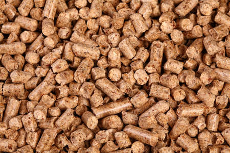 wood pellet: close up image of natural wood pellet background Stock Photo