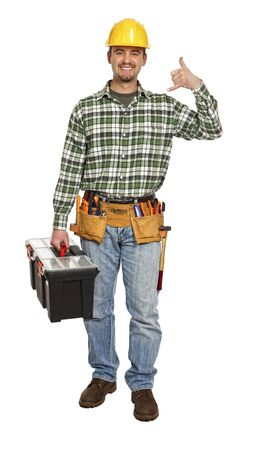 young manual worker in contact us phone pose Stock Photo - 6577453