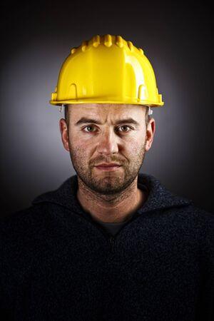 dramatic manual workwer portrait on dark background photo