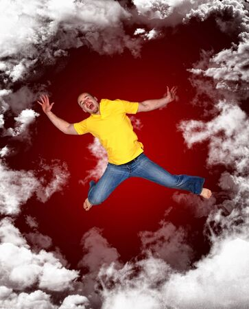 sky  dramatic: young man fall from red sky, dramatic metaphiric image Stock Photo