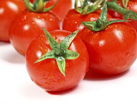 closeup image of red tomatoes on white plane Stock Photo - 6655131