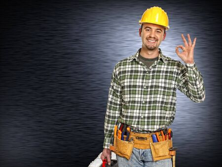 positive handyman and  brushed metal background photo