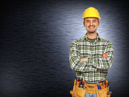caucasian manual worker and  brushed metal background Stock Photo - 6632290