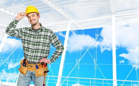 journeyman technician: confident manual worker and modern building background Stock Photo