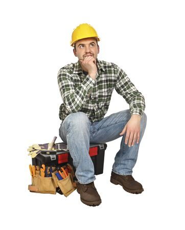 journeyman technician: portrait of young  carpenter sit on his toolbox Stock Photo