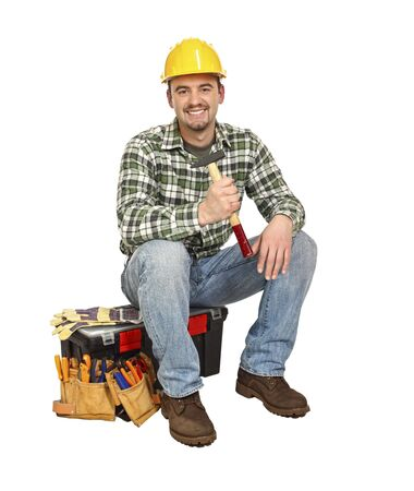 tradesmen: portrait of young  carpenter sit on his toolbox Stock Photo