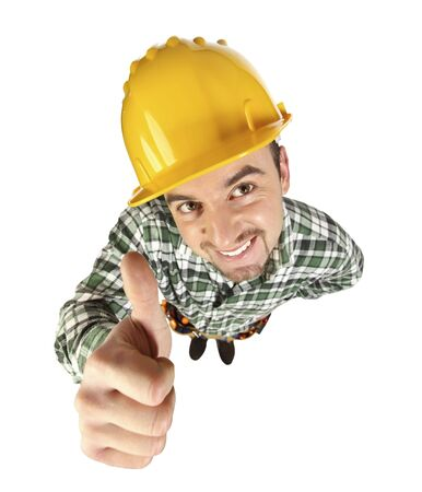 portrait of young funny handyman thumb up photo
