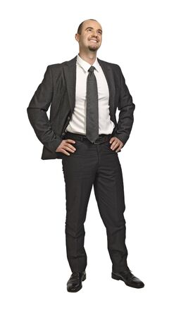 standing young successfull businessman isolated on white Stock Photo - 6713896