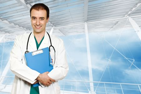 smiling young doctor and modern building background photo