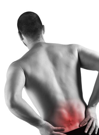 young caucasian man with pain in a back and serious injury photo