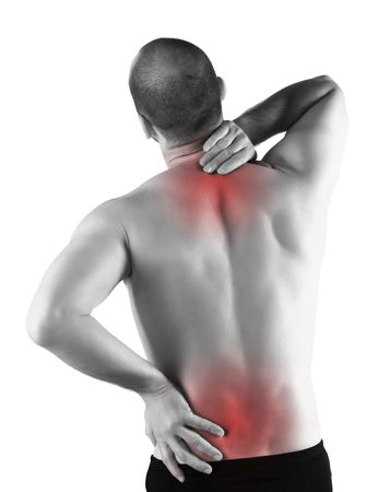 back ache: young man with back pain in the red zone
