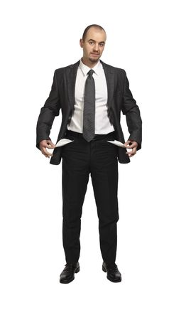 empty pocket: young businessman show his empty pocket on white background Stock Photo