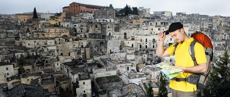 man and fine panoramic view of matera, touristic old town in italy photo