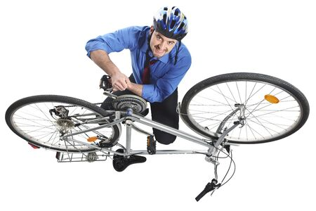 businessman repai his bicycle isolated on white Stock Photo - 7035684