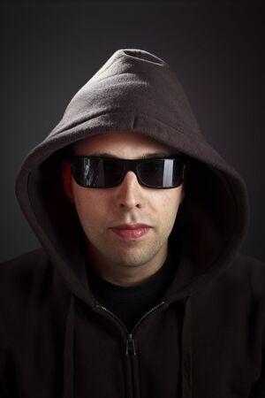 hooded sweatshirt: man with hoodie and sunglasses on dark background