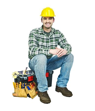 young handyman sit on his toolbox isolated on white photo