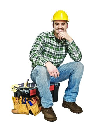 maintenance worker: young handyman sit on his toolbox isolated on white Stock Photo