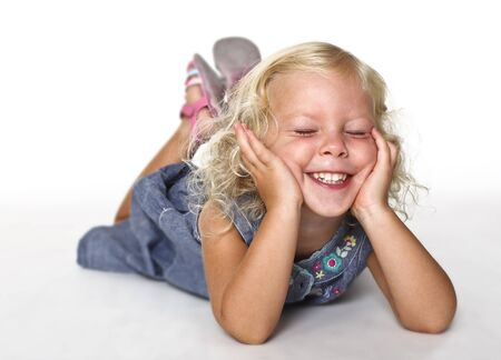 funny young caucasian little girl on white background