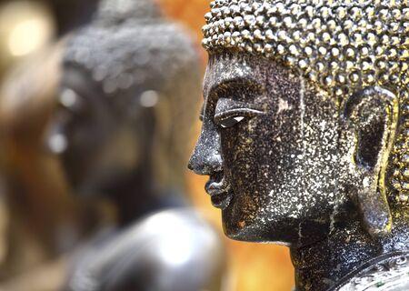 closeup on thai bhudda head, selective focus photo