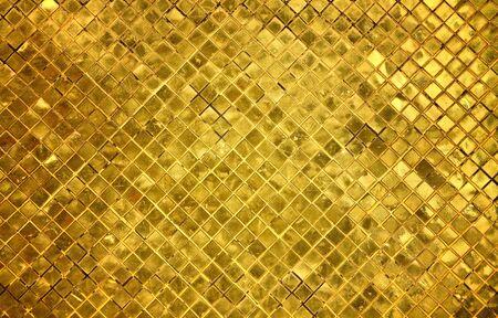 closeup image on golden tile pattern