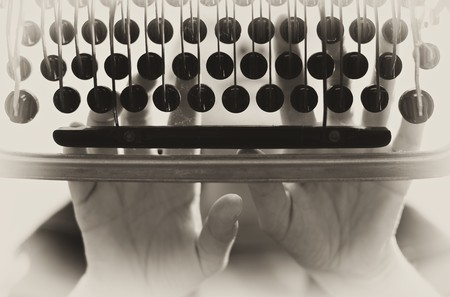 vintage style image of old typewriter machine in action Stock Photo - 7814347