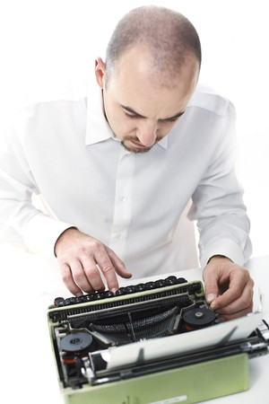 young man with old typewriter selective focus image Stock Photo - 7814365