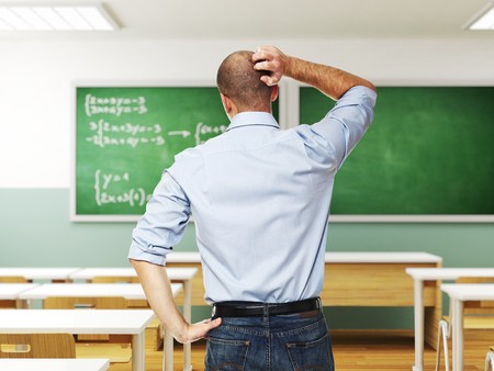 standing man thinking infront of blackboard photo