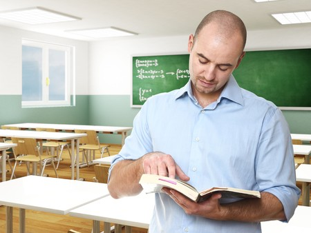 young caucasian teacher in a classroom selective focus image Stock Photo - 8031977